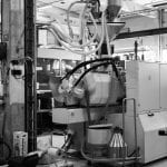 Production machine at NCP for making chairs.