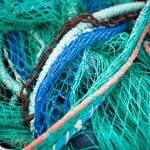 Close picture of fishing nets in colorful colors.