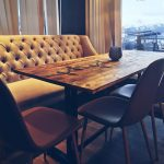 One of the coffee tables at Lille Havfruen Kafé, in retro style and with great view over the near lying fjord and mountains.