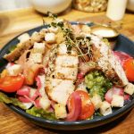 A colorful and delicious homemade and fresh salad with chicken at Lille Havfruen Kafé.