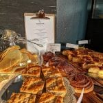 Tempting and beautiful cake buffet at Lille Havfruen Kafé, with everything from waffles to cinnamon rolls.