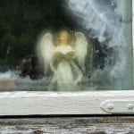 Small angel figure in the window at Inderdalen Farm watching over the farm.