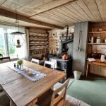 The kitchen in the main building at Inderdalen Farm with a dining table as well to enjoy the delicious home-made food.