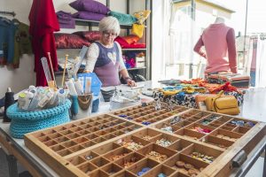 Anne-Lise, the owner of Kråkeslottet, making crafts in her workshop with lots of different materials available.