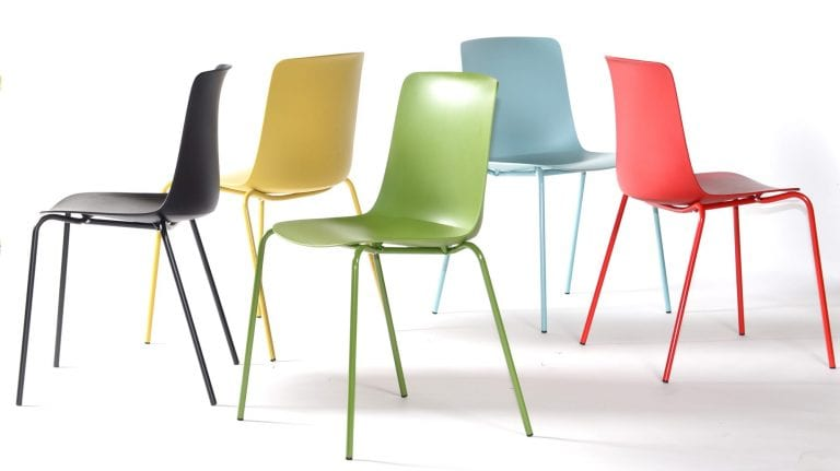 Chairs made at NCP in five different colors: black, yellow, green, blue and red.