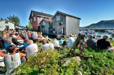 Popular outdoor concert at Lapphella at Hemnesberget during jazz festival right next to the fjord on a warm sunny summer day.