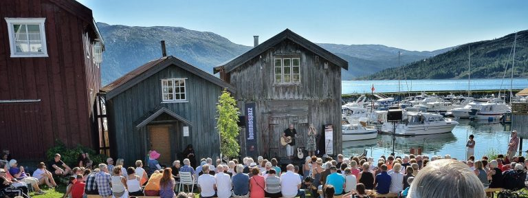 Popular concert at Lapphella at Hemnesberget during jazz festival right next to the fjord on a warm sunny summer day.