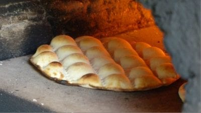 "Close-up of the local bread, ""kamkake"" in the baking oven."