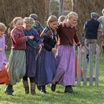 "Young girls dressed in local costumes holding around each other during the local play, ""Klemetspelet"" in Korgen."
