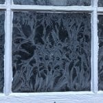Ice formations on a window, turning the window into a piece of beautiful temporary art.