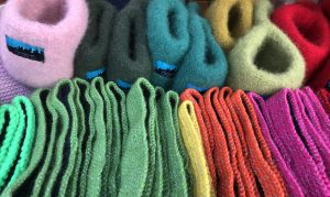 "Colorful products from ""Okstind"" that will keep your head and hands warm on a cold day."