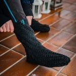 """Knitted socks from """"Okstind"""" in the color black."""