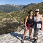 Mom and daughter hiking in the mountain up to the cabin, Rabothytta, and meeting snow on this warm summer day.