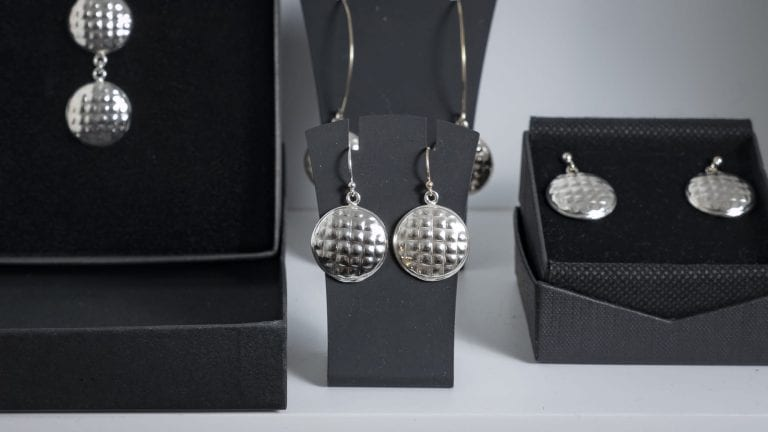 "Beautiful silver jewelry in the shape of the local bread, ""kamkake"", made by goldsmith Merete Mattson."
