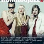 Front cover of Hemnesjazz's festival paper showing three colorful divas/hippies in glittery outfits ready to play music.