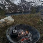 Outdoor fireplace with ready chopped up wood, with a great view over the fjord and white mountains.