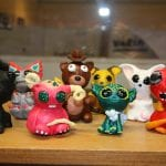 Small colorful creatures made by artist, Yvonne.