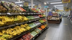 A colorful and full fruit section at one of the local stores, Coop Korgen, with an overview of other sections further in.
