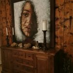 Painting of a trouble girl standing on a wooden desk on a wooden wall in a wooden frame, made by artist, Yvonne.
