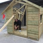 Worker at Hasvo in the process of building a house for a bus stop outside.